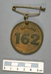 Badge, issued to golf caddies at North Berwick around 1900