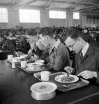 Apprentice shipbuilders eating in the canteen at Babcock and Wilcox's works on Clydeside