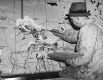 Artist at work on a section of a map of Canada for the Glasgow Empire Exhibition in 1938