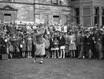 American golfer Bobby Jones drives off from the first tee at St Andrews, 1927