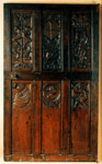 Door made of carved wooden panels