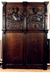 Wall panelling of carved and painted oak