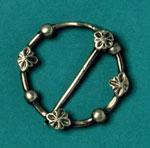 Circular silver brooch