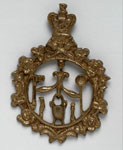 Brass badge of the Plumbers' Association