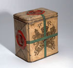 Tin box made to look like a parcel