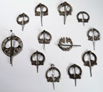 Twelve silver brooches