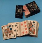 Pack of playing cards in a case decorated with Chinese scenes