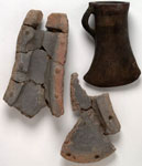 Fragments of a mould, and an axe