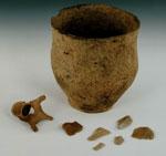 Ceramic pot, flakes of flint, and a human bone