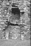 Ground-floor fireplace of east range of Dunstaffnage Castle, at the mouth of Loch Etive, Argyll