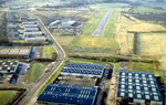 Aerial photo of Cumbernauld airfield with Piper Warrior II on final approach