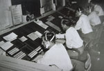 Air traffic controllers monitoring and directing aircraft movements in the Prestwick sector of Scottish air space