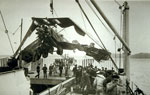 Wrecked Sopwith 1.5 Strutter on HMS Furious being lowered down to the hangar deck 1918