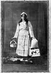 Young woman advertising hen feed, early 20th century