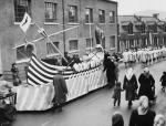 Up Helly A' procession making its way to the harbour in 1957