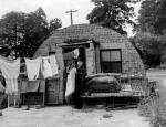 Ex-regular soldier who in 1951, with his wife and six children, is homeless after being evicted from his Nissen hut, where he was squatting due to the drastic post-war house shortage