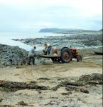 Anchors and chains being tarred at Balintore, Fearn, Ross-shire in 1975