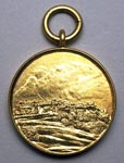 Gold golf match medal