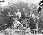 A formal, posed family group of a Selkirk family sitting in their garden in Selkirk, Scottish Borders