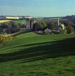 Exterior view of Borthwick Castle and Church in summer landscape, Midlothian
