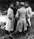 Three German officers and an orderly. Western Front, France. c. 1916-1918