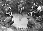 Soldiers washing in a sump hole. Western front, France. c. 1916-1918