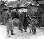 British officer meeting local children. Western Front, France. c. 1916-1918