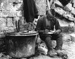 Soldier writing a letter. Western front, France. c. 1916-1918