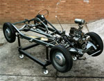 Motor car chassis and sectioned engine