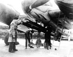 Bristol Beaufighter X of No 489 Squadron Royal New Zealand Air Force having torpedo loaded up at Dallachy circa 1944
