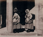Newhaven fishwives standing by doorway
