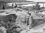 Professor V. Gordon Childe climbing a ladder during excavations at Skara Brae, Sandwick, Orkney, c.1930