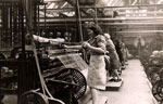 Women operating Atherton warping machines at the Boase Spinning Company Limited, 1946