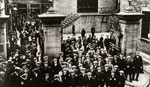 Workers leaving through the factory gates of the Caldrum Works, Dundee, c1920