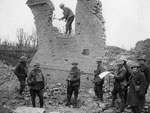 Dismantling a brick wall, France, during World War I