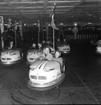 The carnival at the Waverley Market in Edinburgh, showing people enjoying the dodgem cars