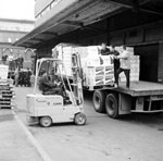 Boxes of whisky being loaded by a forklift onto a truck at the Teacher's whisky factory in Glasgow