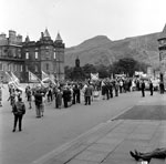 Members march through the forecourt of Holyrood Palace during the SNP Wallace Day rally in Holyrood Park, Edinburgh