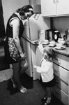 Woman and small child in household kitchen
