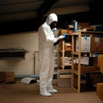 Asbestos testing in protective clothing