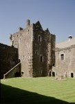 Inner courtyard of Doune Castle, showing the kitchen tower and castle well