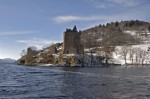 General view of Urquhart Castle and Loch Ness in the snow