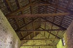 Interior view showing the King post roof over the eastern charcoal shed at Bonawe Iron Furnace