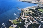 An aerial view of St Andrews Castle, St Andrews Cathedral and St Rule's Church