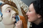 Artist, Yvonne McClement, painting replica Stirling Head number 10, as part of the Stirling Palace Project at Stirling Castle
