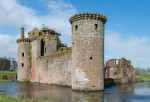 Construction professionals at the top of Caerlaverock Castle as part of an Insight Tour at Caerlaverock Castle