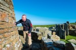 A visitor exploring Broch of Gurness