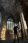 A visitor exploring Elgin Cathedral
