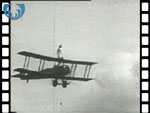 Avro 504K display biplane performing with a wing walker at the Scottish Flying Club pageant at Renfrew in 1933 (video clip)