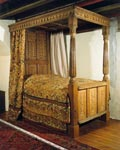 17th century four-poster bed decorated with the arms of Traill of Fife and Orkney